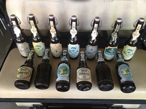 Vintage ceramic top clamp beer bottles 13 in all these bottles are empty $95 for Sale in Varna, IL