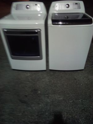 BEAUTFUL KENMORE ELITE SUPER CAPACITY WASHER WITH NO AGITATOR STEAM DRYER for Sale in West Palm Beach, FL