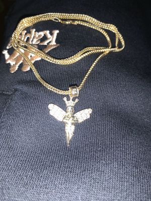 10k Franco chain with a 10k two-tone white gold yellow gold angel pendant for Sale in West Springfield, MA