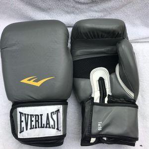 Grey/black 16oz Everlast pro boxing gloves for Sale in Montebello, CA