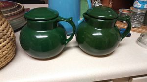 Two little green ceramic coffee pots with lids both are copper coffee carafe made in the USA for Sale in Mesa, AZ