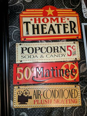 One theater picture in nice frame $20 And metal theater signs $10 for Sale in Houston, TX