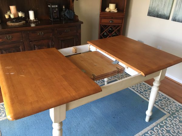 Farm style dining table with 4 chairs and fold away extension