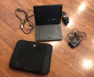 Travel DVD player. Great for kids - includes Swiss Gear case, car charger, wall charger, remote, and connection cables to use with TV for Sale in Clayton, CA