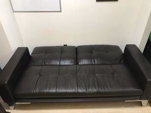 Leather Futon couch bed excellent condition with charging station for Sale in Queens, NY