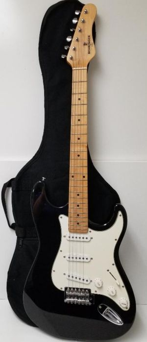 Black and white electric guitar with the Bag and the strap Mint. for Sale in Pasadena, TX