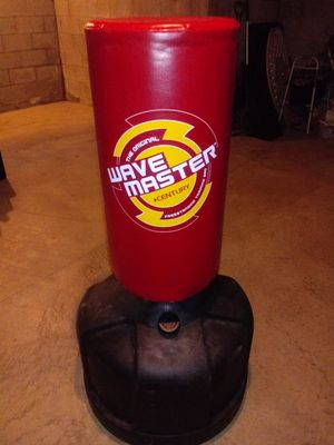 Wave Master adjustable, Red punching bag for Sale in Columbus, OH