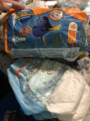 Swimming diapers size 4 open box for Sale in Weehawken, NJ
