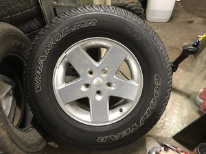 (1) rim and a tire for Sale in Pittsburgh, PA
