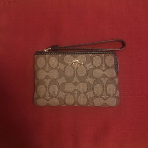 Coach In Signature Canvas Wristlet New for Sale in Lawrence, MA
