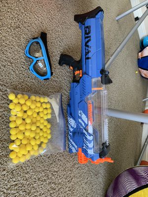 Nerf Rival Nemesis Gun with bullets and safety goggles for Sale in Las Vegas, NV