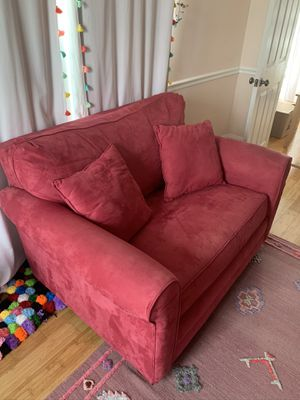 Pink twin pull out couch 58w x 41 with matching storage ottoman 26x41 ottoman small tear in corner (pictured) can be fixed if u know how to sow for Sale in Long Branch, NJ