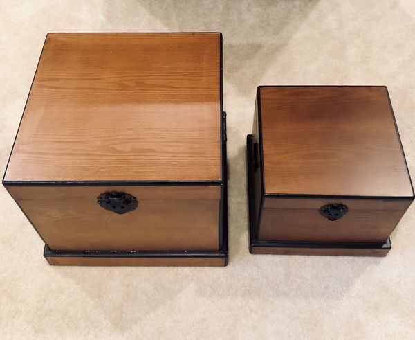 Two hard wood nesting storage boxes with latch
