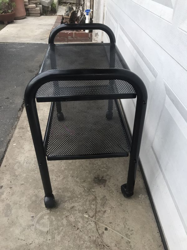 Metal rolling shelves. Great for Garage cuz you can move it around or closets.
