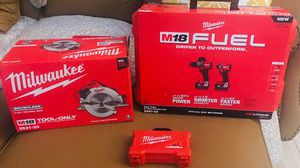 Brand new in box Milwaukee impact driver, hammer drill, 2 batteries, circular saw, charger, case, drill bit kit complete tool set for Sale in Homestead, FL