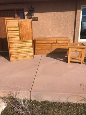Oak bedroom set. Armoire, dresser, and end table for Sale in Colorado Springs, CO