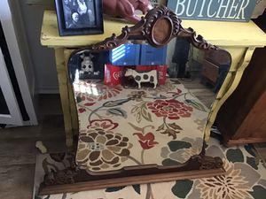 THIS ORNATE ANTIQUE UNIQUE MIRROR YOU CAN HANG OR USE ON A OIECE OF FURNITURE,ORNATE ,CARVED ,BEVELED,IT IS SOLID ,IT IS STURDY ,WAS IN STORAGE ,BEVE for Sale in Downers Grove, IL