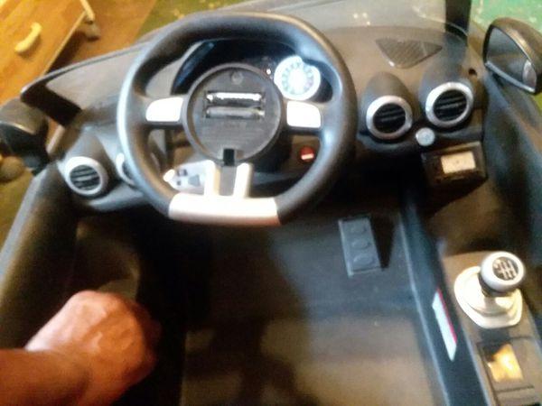 Kid recharging electric power car
