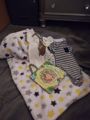 three Carter onesies, baby gear blanket, a peekaboo adventure story book. for Sale in Martinsburg, WV
