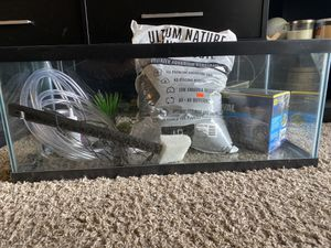 20 gallon tank with unopened Fluval power filter, Ultum substrate, tubing, cleaning brush, fish net for Sale in San Diego, CA