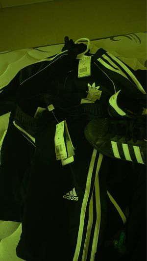 Brand New... NEVER WORN... With Tags...Adidas outfit size M in boys. W/ size 4 1/2 in boys All star matching shoes for Sale in Louisville, KY