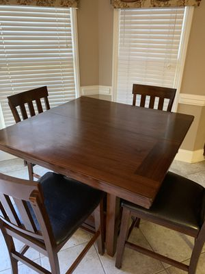 Dining table with 4 chairs and an additional leaf for Sale in Jamestown, NC