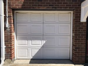 Classic Collection Insulated 8 ft. x 7 ft. White Garage Door with Lift Master Opener Comes with 2 Remotes for Sale in Queens, NY
