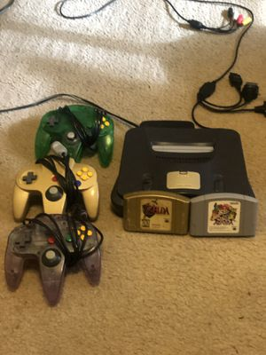 Nintendo 64 with 3 controllers and two games ( Super Smash Bros and Zelda OOT) for Sale in Raleigh, NC