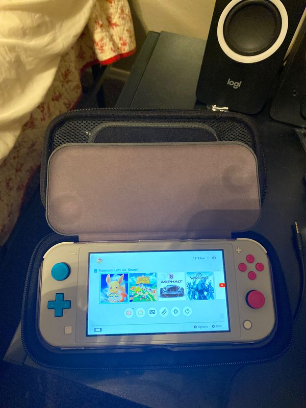 Switch Lite Limited Edition (comes with everything) including Pokémon eevee
