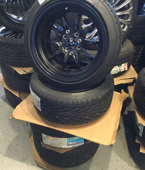 Black JNC 15x8 4x100 Wrapped In Toyo Tires 195/45R15 $899