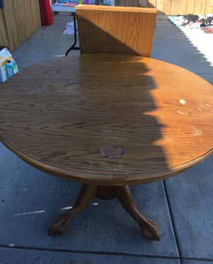 Solid Footed kitchen table with center leaf for Sale in San Diego, CA
