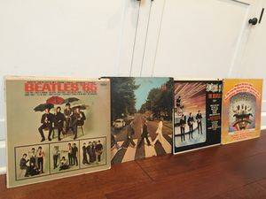 The Beatles, four records good condition. Cardboard shows a little wear. for Sale in Tampa, FL