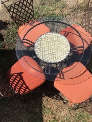 Outdoor iron and mosaic table with glass top. Includes 4 chairs. for Sale in Huntington Beach, CA