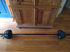 New - 190 lb Olympic Barbell set with 7' Olympic Bar with Spring Clips for Sale in Westminster, CA