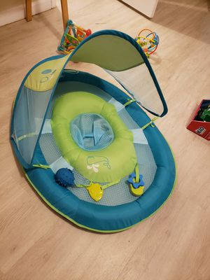 Baby swimming holder and baby toys for Sale in Tampa, FL
