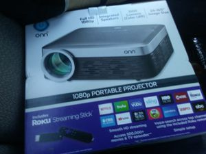 ONN 1080 hp portable projector , W/ ROKU streaming stick for Sale in Everett, WA
