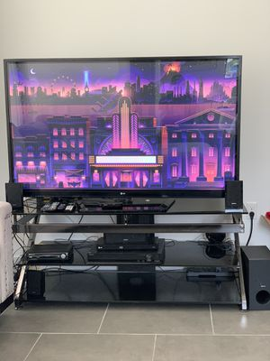 SLEEK, MODERN TEMPERED BLACK GLASS TV STAND for Sale in Miami, FL