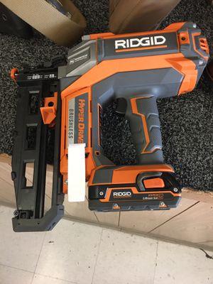 Ridgid nail gun (model: R09892) w/1 battery & charger for Sale in Austin, TX