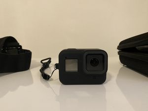 GoPro hero 8 black action camera with accessory kit (extra battery and charger dock, wireless remote, headband, 2 silicone cases and glass screen pro for Sale in Tampa, FL