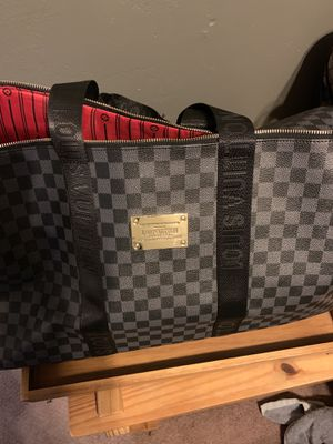 Black and grey Louis Vuitton duffle bag for Sale in Covina, CA