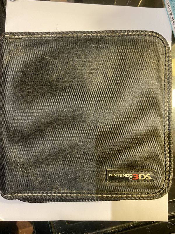 Nintendo 3DS with case and three games