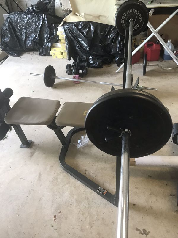 Weights plates 100 lbs with barbell and Clip