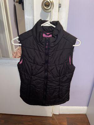 Black vest with pink on the inside for Sale in Belleville, MI