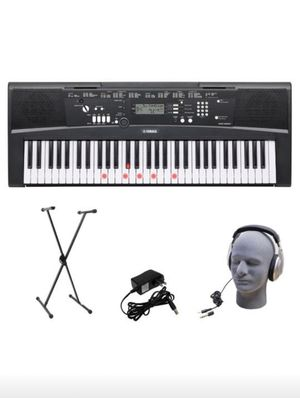 Yamaha EZ -200 61- Lighted key portable with headphones, stand and power supply for Sale in Miami, FL