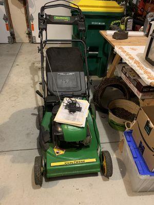 John Deere lawn mower JS35 rechargeable (doesn't work but it should be an easy fix). for Sale in Wichita, KS