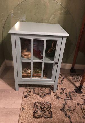 Light blue Glass door cabinet. Shelf inside end table. Nightstand for Sale in Oakland Park, FL