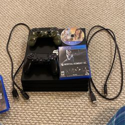 PS4 Pro Bundle With 2 Controllers And 2 Games for Sale in Palos Hills,  IL