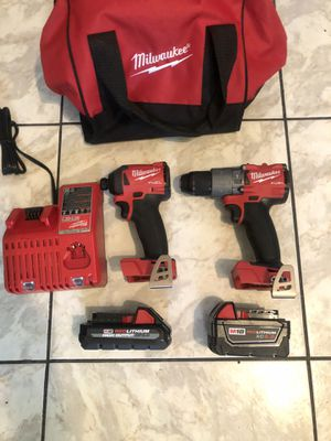 New Milwaukee fuel brushless XR hammer drill set with 3.0 battery and 5.0 battery and charger and carrying case $280 for Sale in Lauderhill, FL