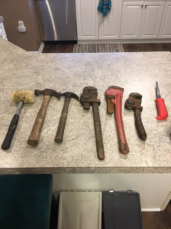 Hammer, wrenches and dry wall saw