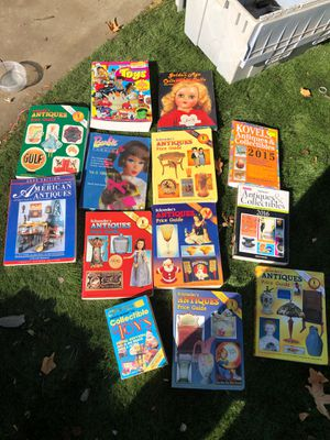 13 collectible price guide picture books Barbie antiques toys dolls for Sale in Fresno, CA